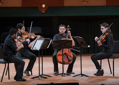 The Lichtenstein String Quartet perform for an audience during the University Orchestra String Ensembles Joint Concert.