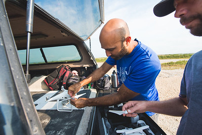 Yeoshua Cohen (left) and Jake Berryhill set up a UAV during the ( tag) Conrad Blucher Institutes survey of Mustang Island following Hurricane Harvey's impact on the Coastal Bend.