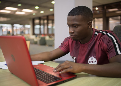 Islander Clevelend Bailey works on his Finance homework in the Mary and Jeff Bell Library.