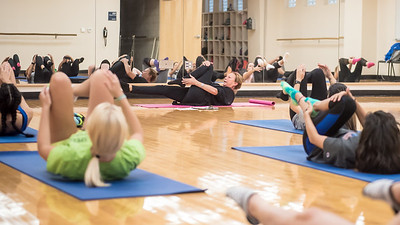 Professor Christy Gorman teaches her students about the different exercise positions during her Pilates course.