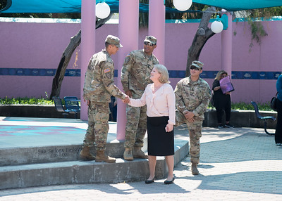 President Kelly Quintanilla shakes hands with ROTC Cadets at the 9/11 Remembrance Ceremony held at the Hector P. Garcia Plaza.