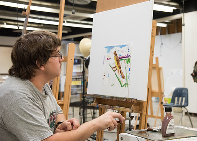 Islander student Stephen Maddux works on his painting for his Advanced Painting class.