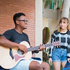 Antony Lametrie (left) plays his guitar in the Center for Instruction Courtyard.