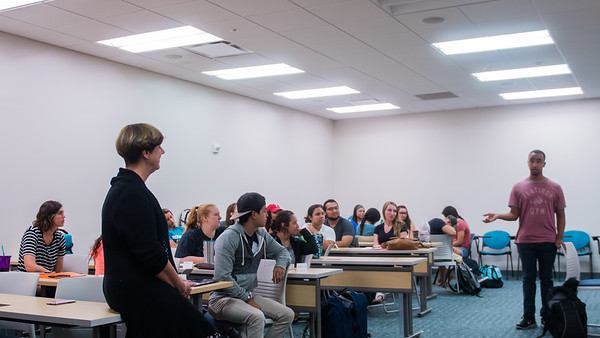 A student answers a question asked by Professor Katelijne Acker during Professional Nursing Issues I.