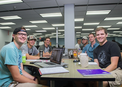 Islanders gather together as they study for their classes in the Mary and Jeff Bell Library.