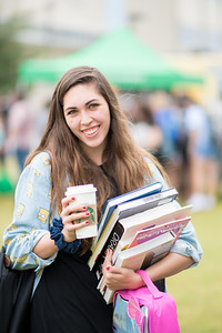 Lauren Champion collected free theatre and social books during the Islander Dining Farmers Market held on the East Lawn.