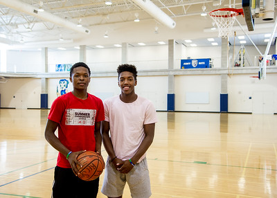 Student Tre Gray (left) and Myles Smith play basketball together in the Dugan Wellness Center.