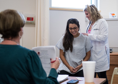 Professor Mary Miller evaluates Tessa Abemathy's (Right) first check off on Alyssa Badillo (Middle) during a Health Assessment class.