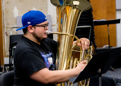 Student Aurelio Villarreal practices his tuba in the Instrumental Ensemble room at the Center for Arts.