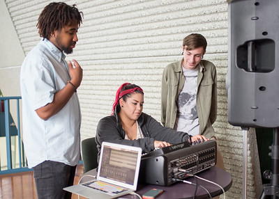 Students learn how to mix different audio clips during a Live Sound Engineering class.