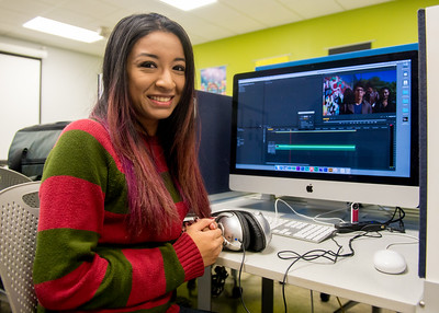 Student Vanessa Moreno edits a music video in the film lab for her Production class.