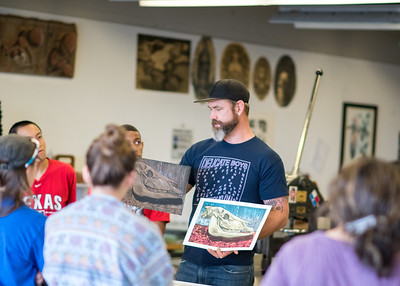 Professor Ryan O'Malley explains to how to apply different colors to the same picture during his Printmaking 1 class