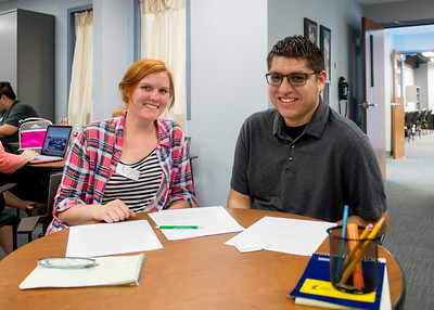 Writing tutor Sarah Reeves (left) helps Ph.D student Jeremy Gonzalez with his dissertation for counselor education degree in the Center for Academic Student Achievement (CASA) writing center.  Click on the link for more info about CASA's services: http://casa.tamucc.edu/