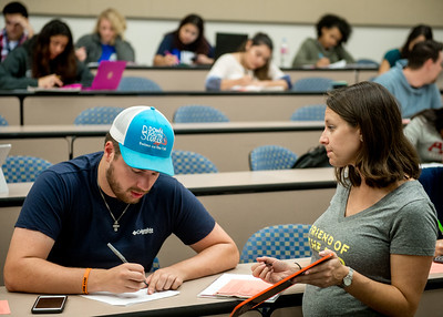 Dr. Amanda Willoughby helps a student with his assignment in her General Chemistry I course.