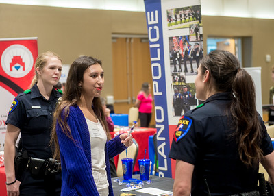Islander student Alexia Martinez talks to representatives from the Portland Police Department at the Careers in Education Fair.
