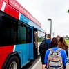 Students take the advantage of on campus shuttle to move between the Island University and Momentum Village.