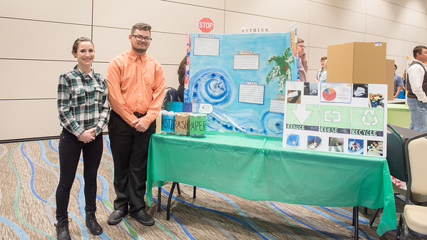 Lindsay Hajek (left) and Anthony Cisneros stand by their poster created for the ESCI 1401 Green Campus Poster Fair.