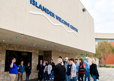 Future islanders and their parents listen to the introduction of Islander Ring Ceremony as the beginning of the campus tour at Islander Welcome Center.