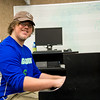 Student Jacob Howard practice on the piano for his music final.