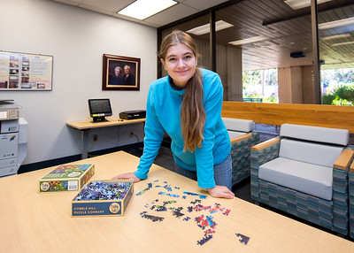 Student Adela Ludeke takes a break from studying to work on a puzzle in the Mary and Jeff Bell Library.