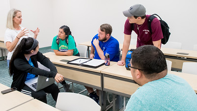 Dr. Misty Kesterson discuss with a group of students about their project in her Managing Leisure Services class.