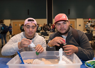 Students Eric Curiel (left) and Michael Noyola make stress balls during Paws on the Island in the University Center.  Check out more events happening during finals week: https://adobe.ly/2BOQZ4n
