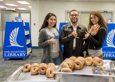 Staff from the Alumni Association tables for Books and Bagels in the Mary and Jeff Bell Library.  Check out more events happening during finals week: https://adobe.ly/2BOQZ4n