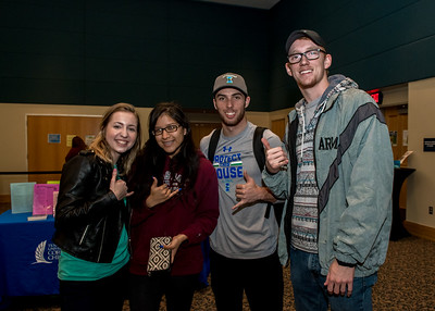 Students Alisha Ward (left), Breanna Martinez, Cotton Arnold, Landon Smith show off their Islander pride during Paws on the Island.  Check out more events happening during finals week: https://adobe.ly/2BOQZ4n