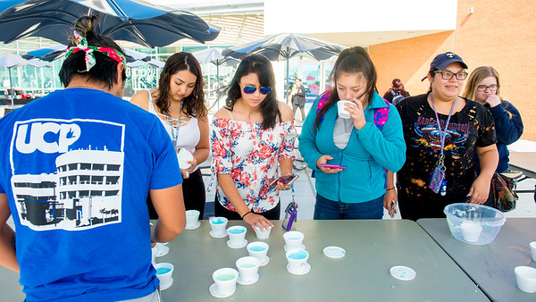 Students choose the slime to help them release stress during the final at the Stress Slime table holding by University Center team.