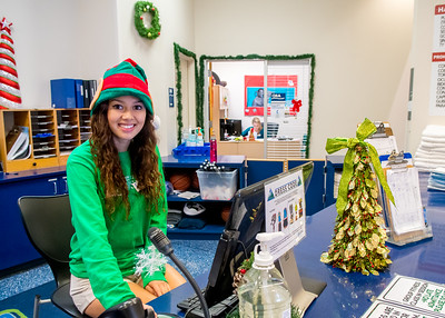 Student Lauren Untalan wear the chrismas hat during her shift as receptionist at Dugan Wellness Center.