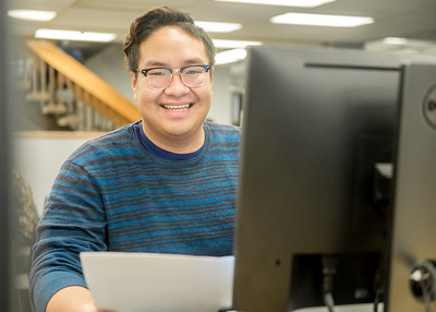 Student Duy Tran take advantage of the computer inside Mary and Jeff Bell Library for his final preparation.