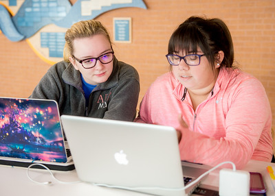 Student Madison Davis (left) and Kristian Lopez study together for their final exam in Bio Chemistry class