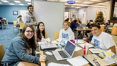 Student Shelby Gould (left), Matthew Martinez, Marcie Balleza, Diandra Mata, and London Worrell study together for their final exam in biology class.