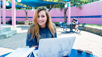 Student Alexandra Wells catches up on her Anatomy and Physiology homework in the Hector P. Garcia Plaza.