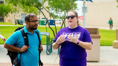 Dr. Alison Marks (right) educates students about National Coming Out Day on the East Lawn.