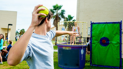 Islander student participates in Dunk a Delta on the East Lawn.