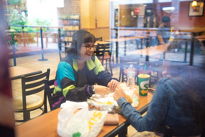 Daisy Fuentes (left) and Maribel Salazar stay dry between class by grabbing a bite to eat at one of the University's dining locations.
