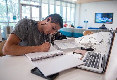 Benjamin Godinez works on his Juvenile Justice assignment in the University Center Tejas Lounge.