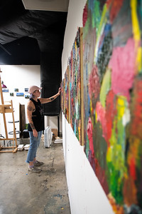 Jade Goldick adds the finishing touches on her abstract paintings that will be featured in the Mary and Jeff Bell Library in mid-November.