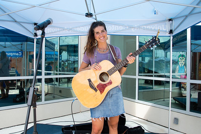 Local Country artist Jade Marie Patek prepares to perform live at the All American Red, White and Blue Cook-Out at the University Center Sea Breeze Patio