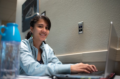 Andrea Jaime utilizes space in the University Center to complete her lab report as she awaits her next class.