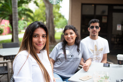 Evelyn Benitez (left), Jenell Soliz and Fahad Alshannam sit outfront the Starbucks patio to hangout on a fresh Thursday afternoon.