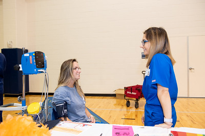 Student Olivia Cohoon (left) has her vitals checked by student Samantha Lohse during the Hispanic Heritage Month Health Fair in the Dugan Wellness Center.