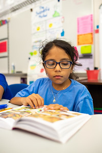 """Student Elena Trevino reads """"The Baby-Sitters"""" in order to test for her weekly AR points in Mrs. Diaz's class."""
