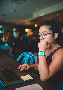 Viviana Villanueva works on her FAFSA application inside the University's personal Starbucks.