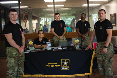 Joseph Helm (left), Jocelyn Richerdson, Donate Pickettay, and Hector DeLeon camp out in the breezeway as they begin fall recruitment for the U.S. Army.
