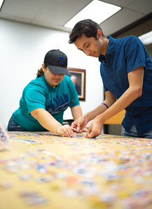 Isriel Lopez (right) and Alejandra Flores work on a 1000 piece puzzle in the Mary and Jeff Bell Library after class.