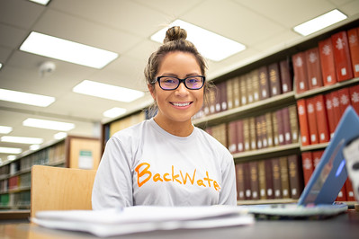 Flor Elizondo works on an assigment for her School and Society Class in the Mary and Jeff Bell Library.