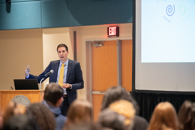 Assistant Professor Daniel Maitland gives a presentation during the Psychology and Sociology Colloquium.