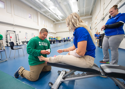 Students from the Kinesiology department run through an obstacle course designed to increase speed when taking care of patients.